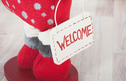 Christmas red decoration with welcome signboard. On a wood floor royalty free stock photography