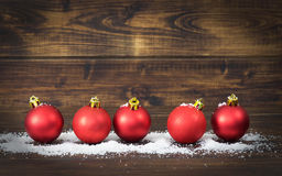 Christmas red decoration on wooden background Royalty Free Stock Photography