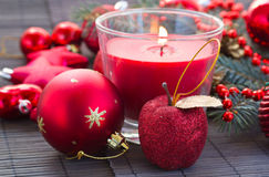 Christmas  red   decorations woth glowing candle Royalty Free Stock Image