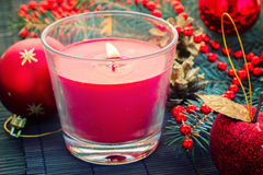 Christmas  red   decorations woth glowing candle Stock Photo