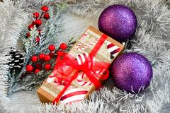Christmas. Red Christmas flower packed gift and snow fir tree. on traditional white wood background Royalty Free Stock Photo