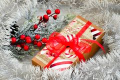 Christmas. Red Christmas flower packed gift and snow fir tree. on traditional white wood background Stock Photo