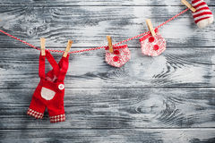 Christmas red garland with doll garments Stock Images