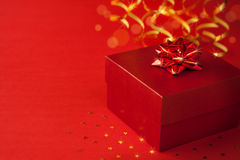 Christmas red gift box with glossy ribbon Royalty Free Stock Images