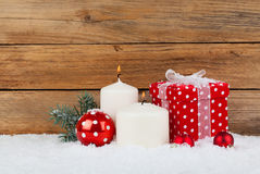 Christmas red gift, candle with snow Stock Photo