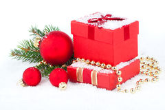 Christmas red gift with festive decorations Stock Image