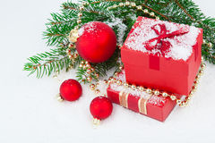 Christmas red gift with festive decorations Stock Images