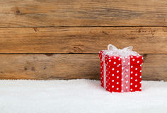 Christmas red gift with snow Stock Photography