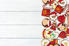 Christmas red gingerbread cookies on wooden background Royalty Free Stock Photography