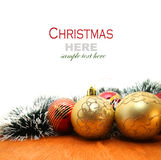 Christmas red and godlen baubles and Spruce Tree Royalty Free Stock Photos