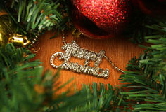 Christmas red and godlen bubbles and Spruce Tree. Christmas decoration (branch of spruce tree, red and golden bubbles,star with Merry Christmas words in the stock photos