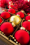 Christmas red and gold balls on the wooden table Royalty Free Stock Photos