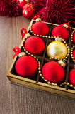 Christmas red and gold balls on the wooden table Stock Image