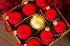 Christmas red and gold balls on the wooden table Royalty Free Stock Images
