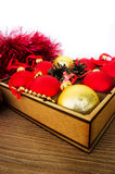 Christmas red and gold balls on the wooden table, selective focu Royalty Free Stock Images