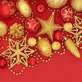 Christmas Red and Gold Glitter Baubles. Christmas red and gold bauble decorations forming a background Stock Image