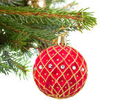 Christmas red and golden ball on fir tree Stock Photo