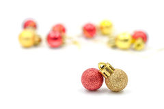 Christmas red and golden balls ornament with blurred decorations Royalty Free Stock Image