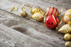 Christmas red and golden toys  on  wooden background Royalty Free Stock Image