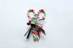 Christmas red and green candy cane with thank you note in heart. Christmas candy cane with thank you note on white background, heart shaped Stock Photography