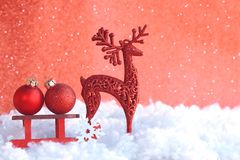 Christmas red greeting card, toy wooden sled, two ball, deer. In snow, vintage retro style stock images