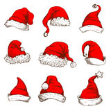 Christmas red hat or cap of Santa and elf icon set Royalty Free Stock Photography