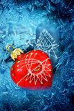 Christmas red heart on frosty background Stock Photos