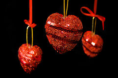 Christmas red hearts hanging Royalty Free Stock Image