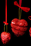 Christmas red hearts hanging Stock Photo