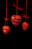 Christmas red hearts hanging Royalty Free Stock Photo
