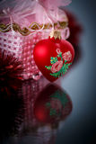 Christmas red hearts with red garland Royalty Free Stock Photos