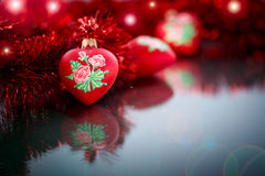 Christmas red hearts with red garland Stock Images