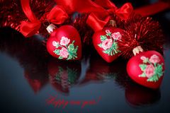 Christmas red hearts with red garland Stock Image
