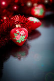 Christmas red hearts with red garland Royalty Free Stock Photo