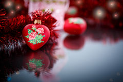 Christmas red hearts with red garland Royalty Free Stock Photography