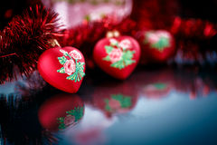 Christmas red hearts with red garland Stock Photo