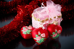 Christmas red hearts with red garland Royalty Free Stock Images