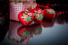 Christmas red hearts with red garland Stock Photos