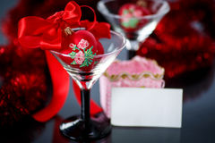 Christmas red hearts with red garland Stock Photography