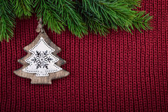 Christmas red knitted background with christmas tree decoration in country farmhouse style Royalty Free Stock Photos