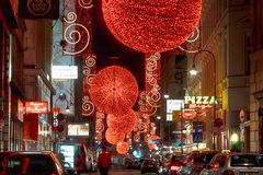 Christmas red light balls on a street Royalty Free Stock Image