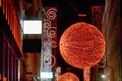 Christmas red light balls on a street Stock Images