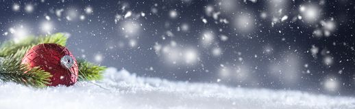 Christmas red Luxury ball in snow and abstract snowy atmosphere stock images