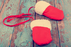 Christmas red mittens on wooden boards Stock Image