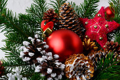 Christmas red ornament and golden decorated pine cones Royalty Free Stock Photo