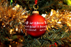 Christmas red ornament, Let it snow! Royalty Free Stock Image