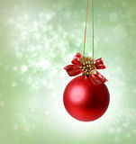 Christmas red ornaments. Over green tree lights background Stock Photography