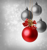Christmas red ornaments. Over silver lights background Stock Photography