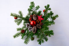 Christmas red ornaments and snowy decorated pinecone wreath stock photos