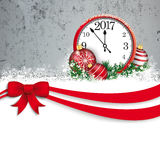 Christmas Red Ribbon Bauble Even Clock 2017 Concrete. Christmas card with red ribbon, snow, clock, baubles and concrete wall Stock Photography